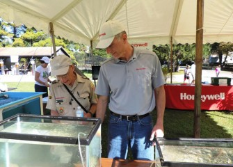 Don Augustine, left, a Boy Scouts of America aquatics instructor, views fish on display with Honeywell Syracuse Program Director John McAuliffe.