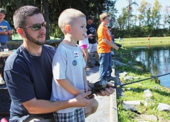 Nicholas Majerus of Cicero eagerly waits for a fish to bite on his line with his father, David Majerus.