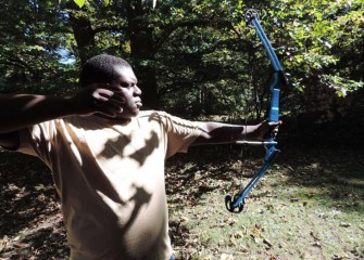 A proper stance is important to successful shooting.  Nizair Evans has just released his arrow.