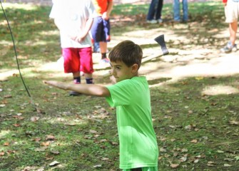 In another area of the park, participants learn how to throw a tomahawk.  Maxwell Broccoli aims for the round wood block target.