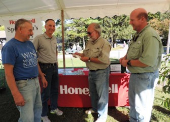 Stephen Wowelko, 2014 recipient of the Honeywell Hometown Heroes Award, checks out one of the free lures Honeywell provided to Sportsmen's Days participants.