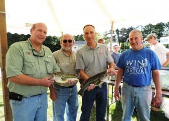 Showing off a pair of healthy largemouth bass from Onondaga Lake are from left William Lansley, Onondaga County Parks commissioner; Stephen Wowelko; John McAuliffe; and David Simmons, president of the Onondaga County Federation of Sportsmen's Clubs.