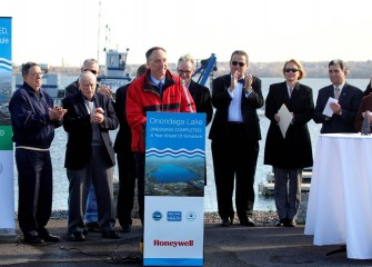 Honeywell Syracuse Program Director John McAuliffe, surrounded by community members and elected officials, announces the end of dredging.  About 2.2 million cubic yards of material were removed from the lake bottom.