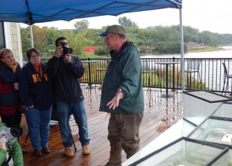Participants listen as Neil Ringler, Ph.D. (right), fisheries expert and vice provost of research at SUNY-ESF, gives an overview of the fish communities in Onondaga Lake.