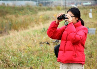 Wendy Huang, SUNY-ESF student, assists with citizen science monitoring near Geddes Brook, which is part of the Onondaga Lake Important Bird Area watershed.