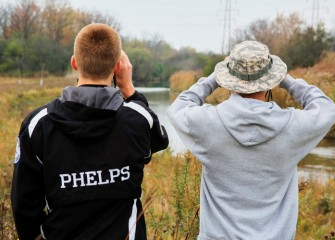 Brad Phelps and R.J. Herrick of Tully track native birds along Geddes Brook.