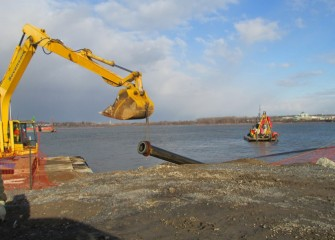 A pipe is removed as work on the lake concludes for the season.