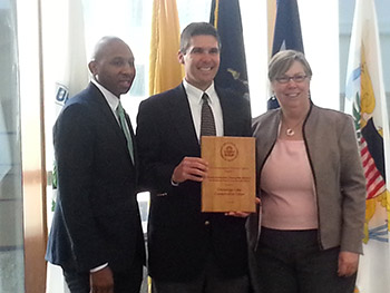 Chris Lajewski, director of Montezuma Audubon Center, accepts a 2015 Environmental Champion Award from EPA Regional Administrator Judith Enck on behalf of the Onondaga Lake Conservation Corps. Donovan Richards, Chair of the New York City Council's Committee on Environmental Protection, is on the left.