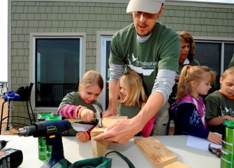 Building in the right dimensions is critical to attracting desired species. Mark Bremer, of Manlius, constructs a bird box with his daughters Sammie (left) and Ali.