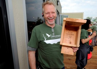 "Peter Haun, from Fairmount, displays a box he helped build with a ""Welcome Home"" message for birds."