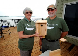 Onondaga Lake Conservation Corps volunteers Cheryl and Robert Belle, from Plainville, with the Tree Swallow box they assembled. Tree Swallows prefer to nest in a open area such as near wetlands or a lake.
