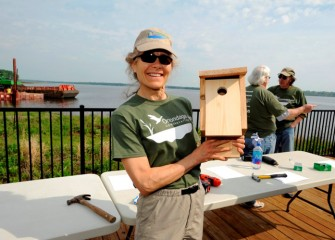 Onondaga Audubon member and Corps volunteer Ruth Florey with a breeding box to be installed along the shoreline.