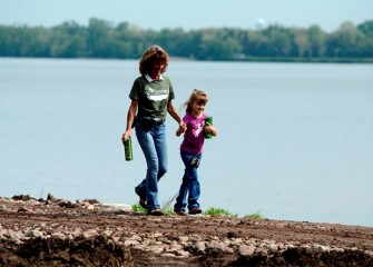 Karen Cahill and her daughter, Grace, walk along Onondaga Lake.