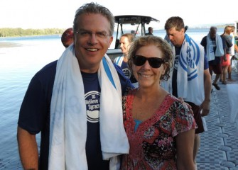 Onondaga County Legislators Tim Burtis (left), Brewerton, and Kathy Rapp of Liverpool, return to shore after enjoying an inaugural swim.