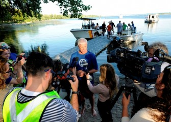 NYSDEC commissioner Martens, speaking to media on the lake shore.