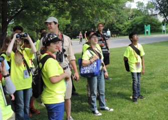 Students engage in hands-on activities throughout the week including studying local birds in their habitats.  Here Frank Moses, Onondaga Audubon volunteer and bird expert, helps students spot birds around Onondaga Lake.