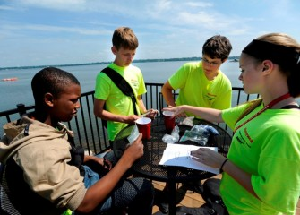 Students learn about capping in Onondaga Lake, which continues through 2016, by performing a hands-on experiment.