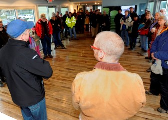 After arriving at the Onondaga Lake Visitors Center, participants are welcomed by Christopher Calkins (left), Vice President at O'Brien & Gere and fellow Onondaga Lake Conservation Corps volunteer.