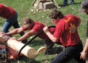 The SUNY College of Environmental Science and Forestry Woodsmen Team is the oldest student organization on campus, founded in 1912.  Here a team member uses a bow saw to cut a log; this activity is often done as a relay race in competition.