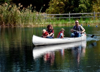 Gianna Commito and Scott Olson, from Kent, Ohio, take their children for a ride in a canoe.