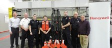 Solvay Fire Department received more than $5,000 worth of water rescue equipment, including personal flotation devices, buoys, lights, and stretchers. Pictured left to right are Honeywell Syracuse Program Director John McAuliffe, Chief of Fire Tom Spaeth, volunteer firefighter Heidi Armstrong, volunteer firefighter Jayson Kellogg, volunteer firefighter and EMT Steve VanOrden, volunteer firefighter Bob Zingaro, and Honeywell's Advisor for Emergency Preparedness Peter Alberti.