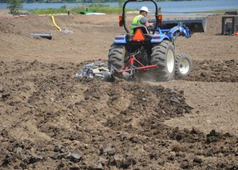Topsoil is plowed to facilitate plant installation.