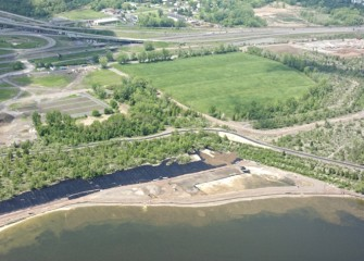 Liner is placed along sections of the Western Shoreline before clean sand and topsoil are brought in.