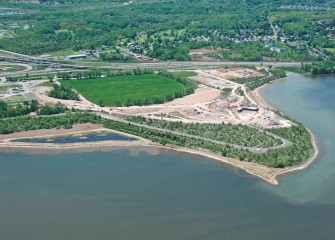 Construction is under way on the county's Lakeview Amphitheater along the western shoreline of Onondaga Lake. A newly created wetland is visible to the left.