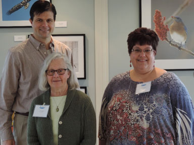 The exhibit featured images taken by local photographers (left to right) Greg Craybas, Cheryl Lloyd, and Michele Neligan. Not pictured: Suzanne Ray, Jonathan Kresge, and John Savage.