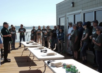 Steve Mooney (left), Project Scientist with OBG, briefs volunteers Saturday morning before activities begin to build and install habitat structures and engage in citizen science monitoring.
