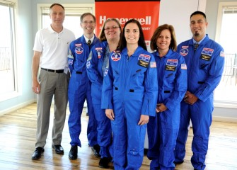Honeywell Syracuse Program Director John McAuliffe welcomed and presented flight suits to 2016 Honeywell Educators at Space Academy (left to right) Stephen Bacon, Heather Bermingham, Susanne Sobon, Donna Erikson, and Carmen Primiano.
