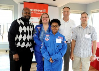 From left are Westside Academy at Blodgett principal Alonzo Graham, Westside Academy teacher Heather Bermingham, Tyara Oliver, John McAuliffe, and Scott Daley, HESA 2013, of Frazer K-8 School. Tyara Oliver, a student at Frazer K-8 School, will attend a student-oriented education program at Space Camp in August.
