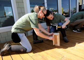 Tracey (left) and daughter Corrin Stellakis, from Bridgeport, NY, assemble a bird box they will later install along the western shoreline of Onondaga Lake.