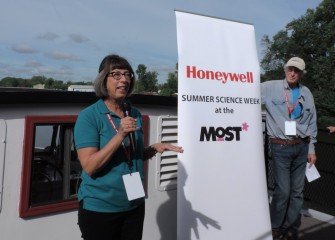 Milton J. Rubenstein Museum of Science & Technology (MOST) President Toni Martin (left) welcomes students aboard the Emita II on Opening Day of Honeywell Summer Science Week. Also shown is MOST Chief Program Officer Peter Plumley, Ph.D., who heads the weeklong hands-on science program.