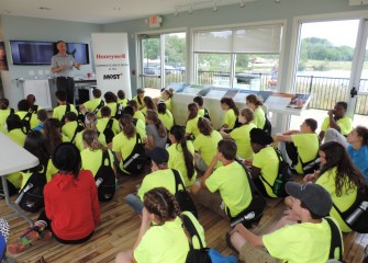 On Friday, Honeywell Day, Summer Science Week students visit the Onondaga Lake Visitors Center, where they are welcomed by Honeywell Syracuse Program Director John McAuliffe.