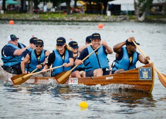 Governor Andrew Cuomo (second from right) and his team compete in the inaugural Governor's Cup canoe race Saturday morning at the Onondaga Cup and Lakefest. The regatta was produced by Syracuse Media Group, in partnership with the Chargers Rowing Club.