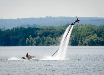A flyboard, or jet board, demonstration takes place on the lake before heats, or preliminary races, of the corporate regatta begin.