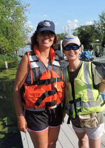 """Volunteering to help remove the water chestnut plants from Onondaga Lake was so rewarding. What our group was able to accomplish in a very short amount of time was astounding,"" said Diane Mantooth, of Clay, New York, pictured above (left) with Lisa Wang, of Fayetteville, New York. ""I look forward to doing more to help save this incredible community resource. I am proud to be a part of the effort."""