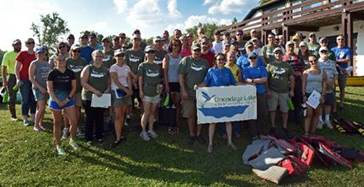 Onondaga Lake Conservation Corps volunteers pledge to protect and conserve the natural resources of Onondaga Lake, promising to educate future generations about becoming caretakers of the water, air, land, and wildlife. Fifty-eight volunteers participated in the event.