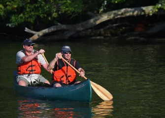 Jim Rhea (left), Principal Engineer and Partner at Anchor QEA, and Dave Fergot, Deputy Commissioner of Onondaga County Parks, continue down Seneca River in search of more water chestnut.