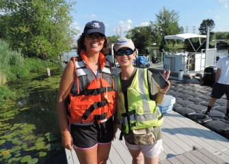 Diane Mantooth (left), a first-time Corps volunteer from Clay, and Lisa Wang, a returning volunteer from Fayetteville, enjoyed working together on a stewardship project that helps our local waterways.