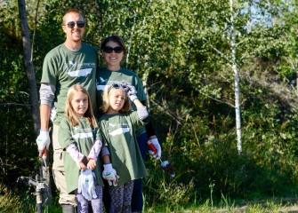 Mark and Elizabeth Bremer, of Manlius, brought daughters Sammie (left) and Ali to also volunteer. Corps members pledge to educate future generations about becoming caretakers of the water, air, land, and wildlife.