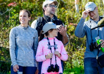 Jeff (right) and Laura McIlroy, of Camillus, and their niece, Ava Purtell, 10, from Baldwinsville, enjoy learning about the variety of birds seen at Onondaga Lake from Onondaga Audubon Society board member Frank Moses (in back).