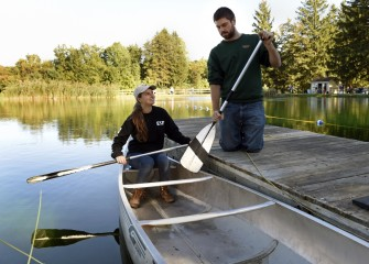 Serena Kucera, an acquatics and fisheries student at SUNY ESF, and Michael Kolis, from Marcellus, use a portion of the Time Out to Fish Pond for canoeing.