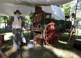 A new area at Sportsmen's Days this year included various living history displays. Doug Corey, from Phoenix, New York, stands with his authentic restored chuck wagon.