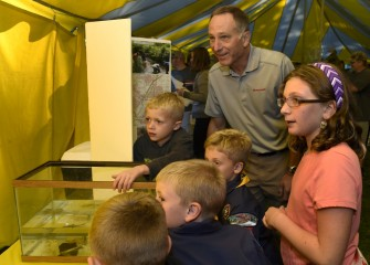 Honeywell Syracuse Program Director John McAuliffe enjoys viewing displays with Cub Scouts and others in attendance.