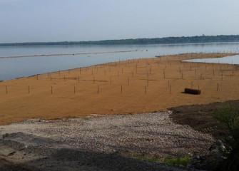 Seeding and installation of erosion control mat is completed on the eastern point by Nine Mile Creek.