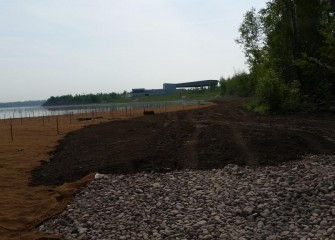 After planting, the shoreline is covered with topsoil.