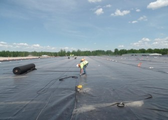 A worker seals cover liner sheets together.