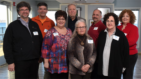 This year's exhibit featured 11 local photographers, more than any other year. The photographers pictured left to right (front row): John DeNicola, Michele Neligan, Cheryl Lloyd, Carol Keeler, (back row): Warren Wheeler, Tom Lloyd, Phillip Bonn and Diana Whiting. Not pictured: Greg Craybas, Jonathan Kresge and John Savage.